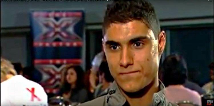 Headshot of X factor contestant Emmanuel Kelly.