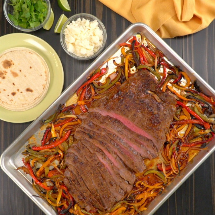 Looking down on flank steak broiled with fajita peppers