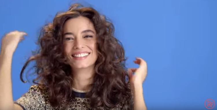 Get loose, wild curls in your hair by using a flat iron