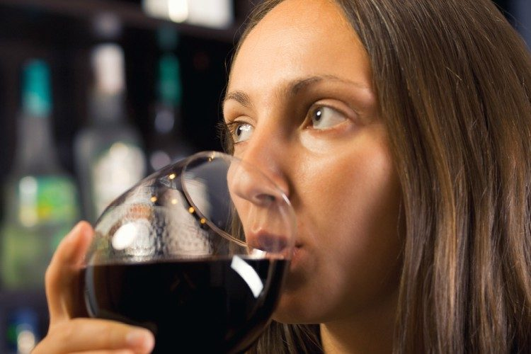 Image of woman drinking wine.