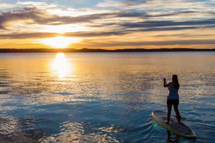 woman paddle boarding