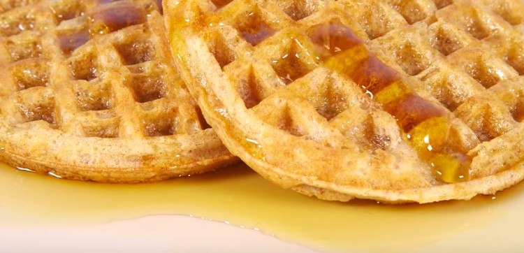 close-up of waffles and syrup