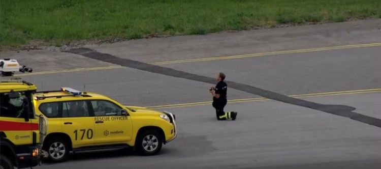 Image of firefighter taking a knee.