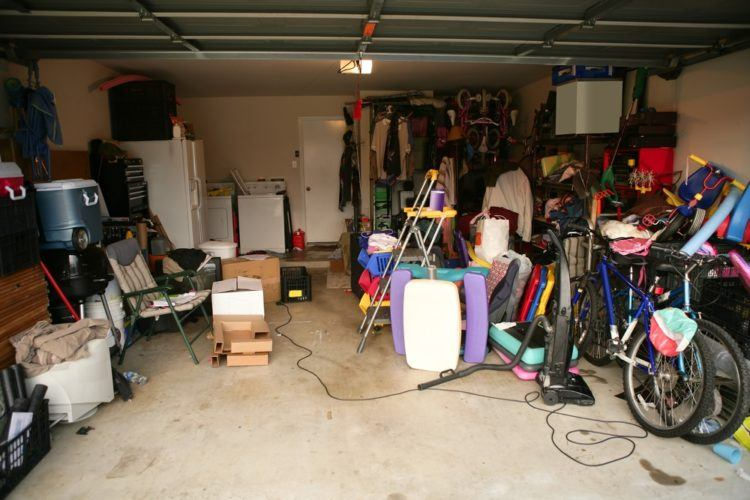 Messy garage filled with clutter.