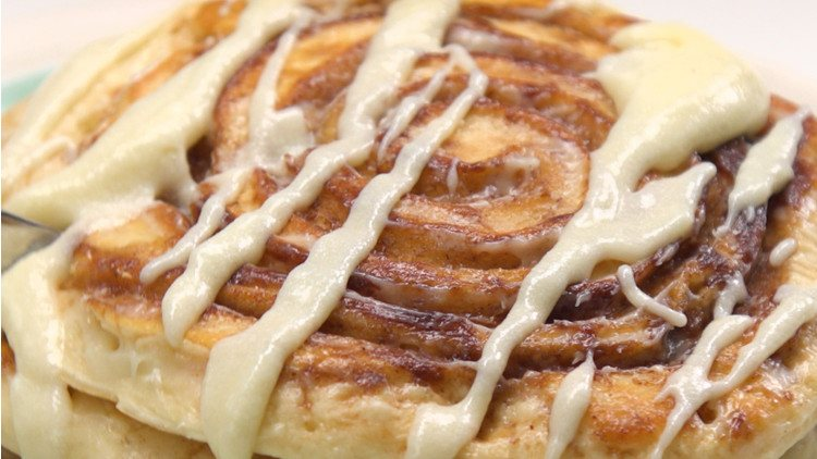 Cinnamon Roll Pancakes fork cutting in