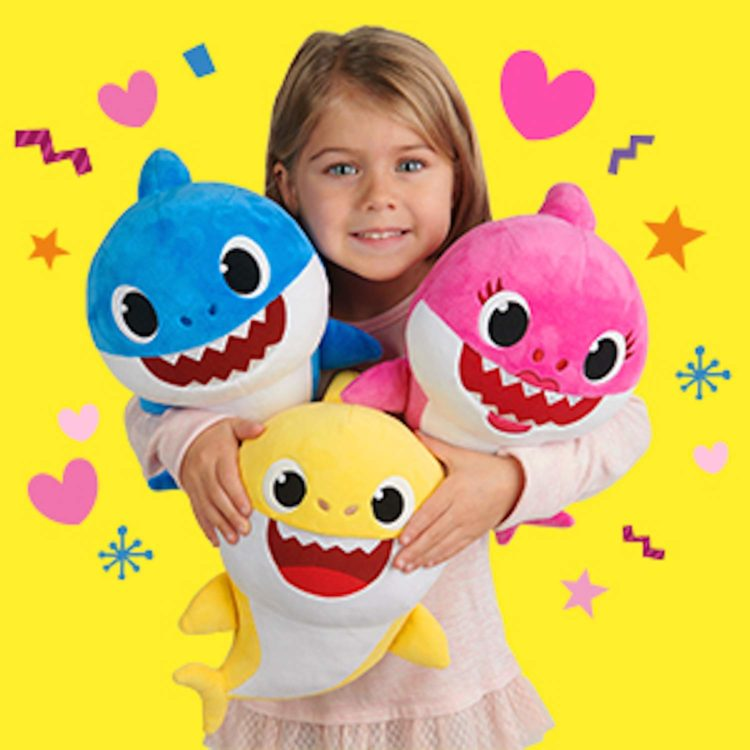 Image of girl with three baby shark dolls