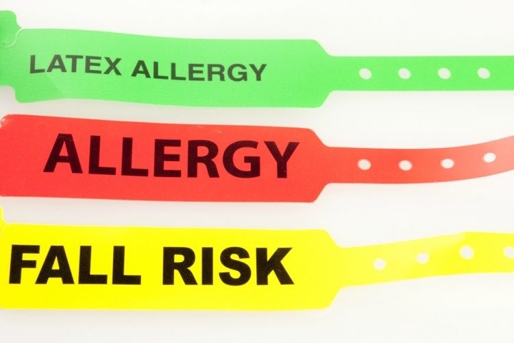 Green, red and yellow hospital wristbands for different allergies and concerns