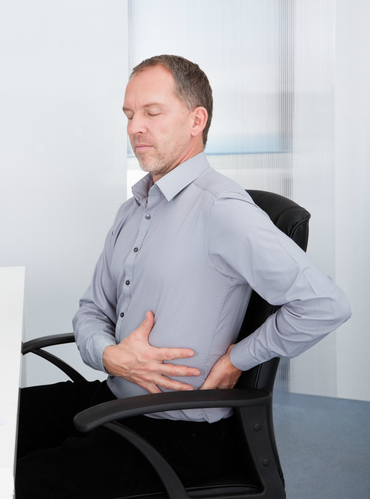 Image of businessman suffering back pain.