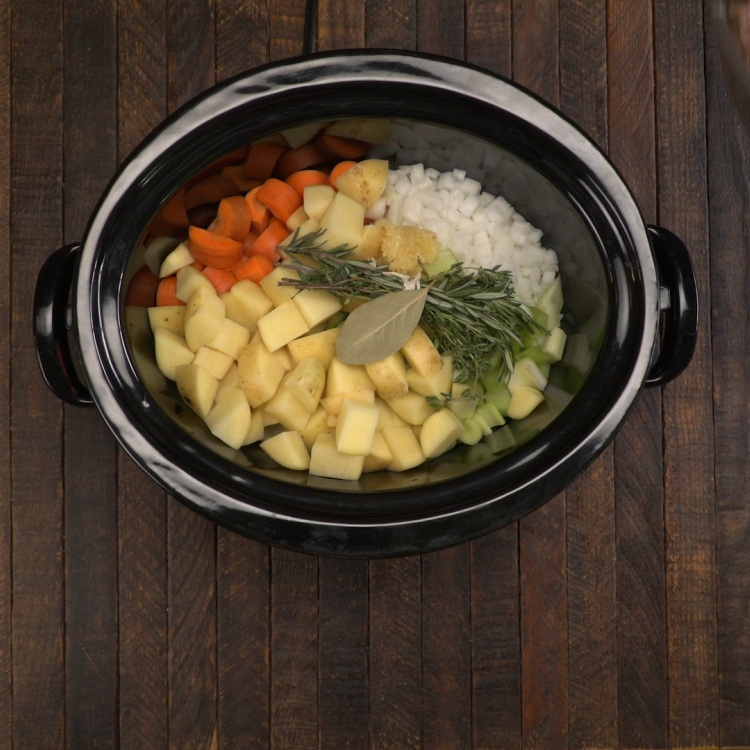 Potatoes, celery, carrots, rosemary, bay leaf and onion for slow cooker beef stew