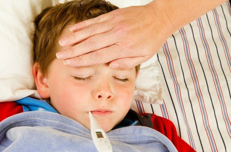 Image of child with thermometer in mouth.