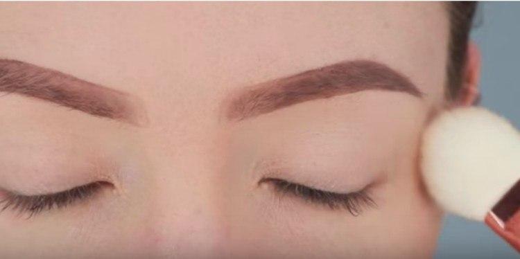 close-up of eyes and brush