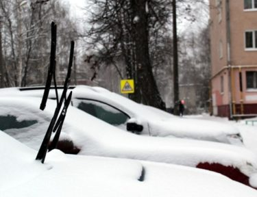 Image of cars with wipers up.