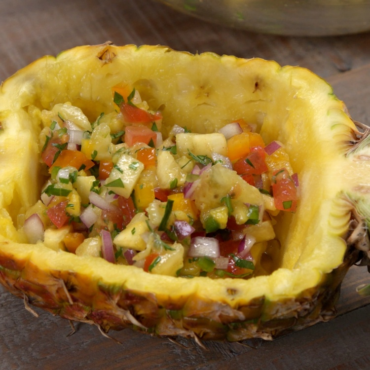 Fill pineapple halves with salsa