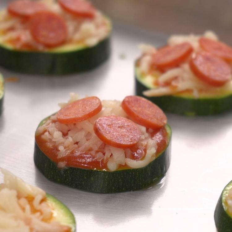 Close shot of zucchini pizza on sheet tray