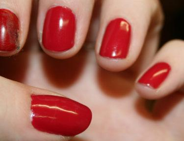Image of red polished nails.