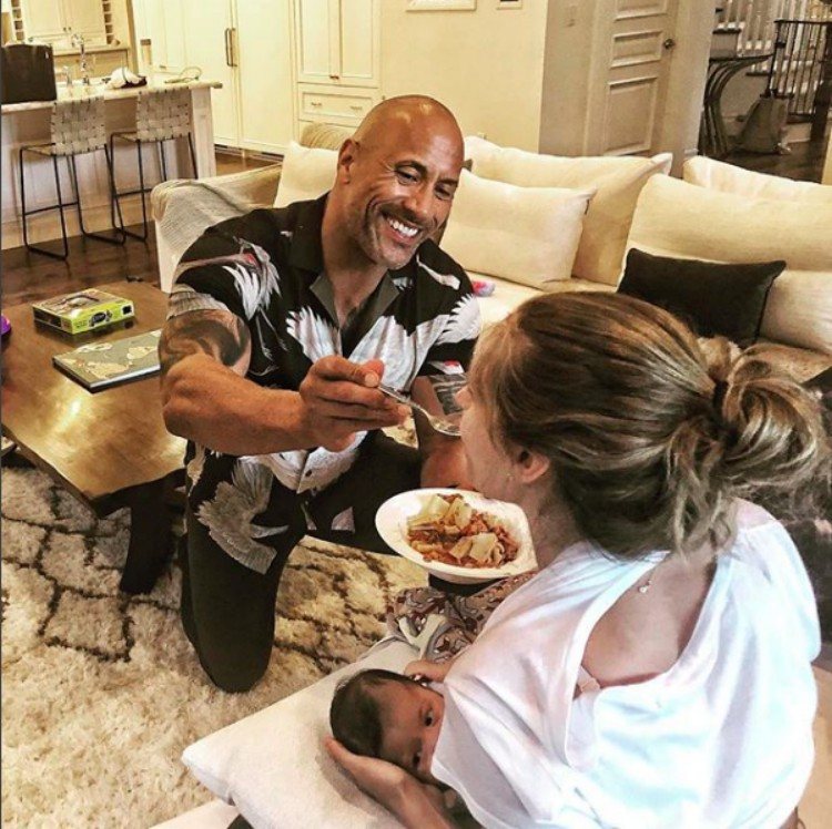 Image of Dwayne Johnson feeding girlfriend.