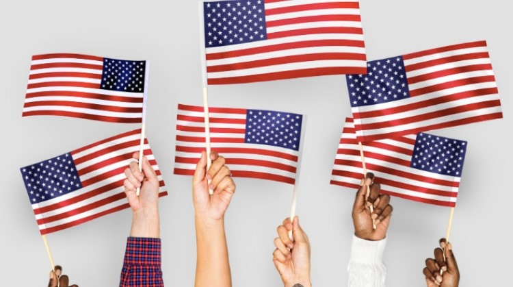 Image of people holding American flags.