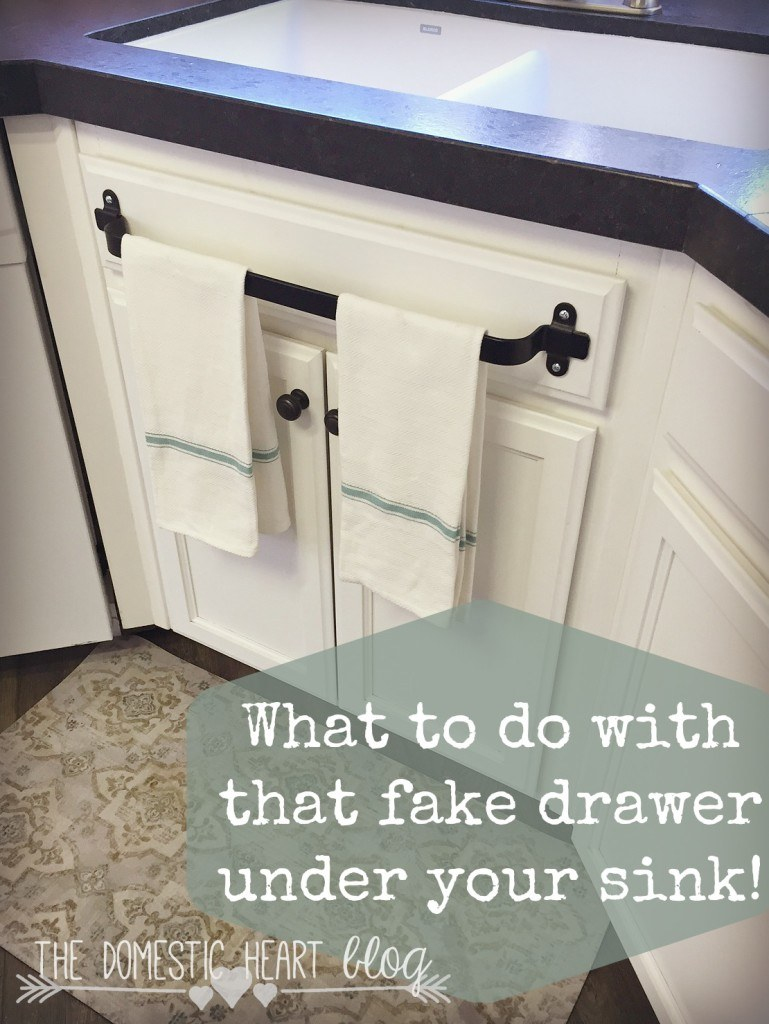 Towel bar on fake kitchen drawer.