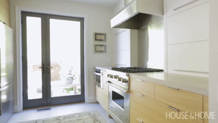 Kitchen after renovation with asymmetrical back door