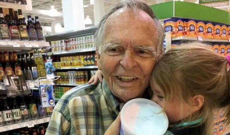 norah hugs Mr. Dan at the store