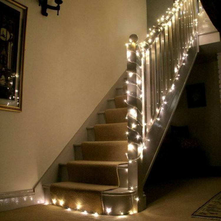 Stairs draped in fairy lights.