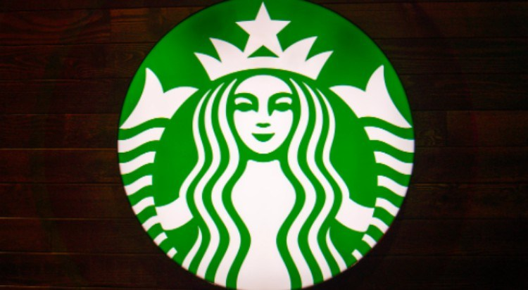 Starbucks logo against wood
