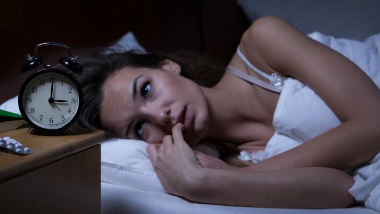 Woman lying in bed sleepless