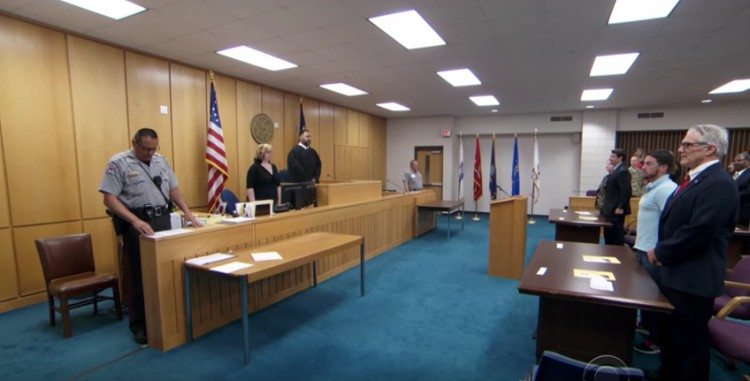 Judge Olivera at work in the courtroom.