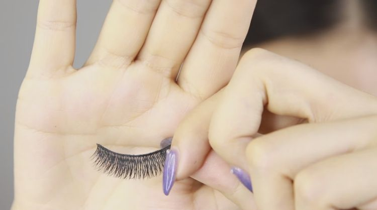 Use fake lashes with a bigger band to fake liner look