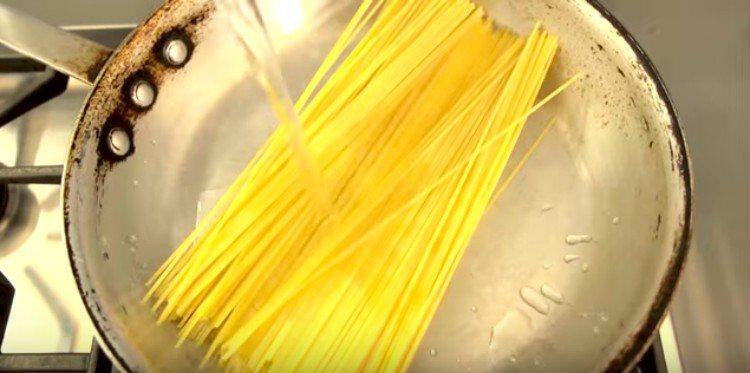uncooked noodles in saute pan