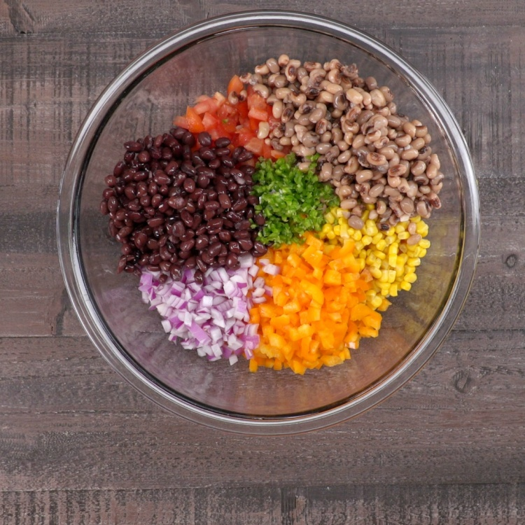 Black beans, black-eyed peas, corn, peppers, tomatoes and onions for cowboy caviar