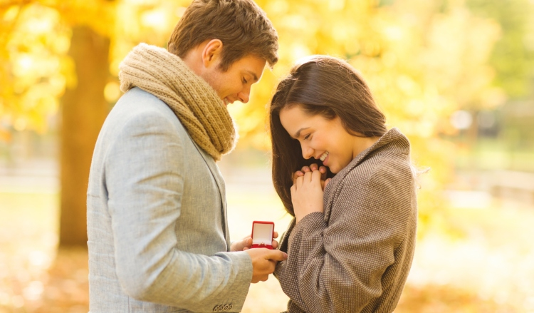 Image of happy couple looking at ring