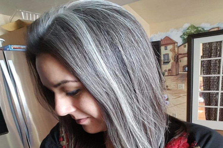 Image of young lady with grey hair.