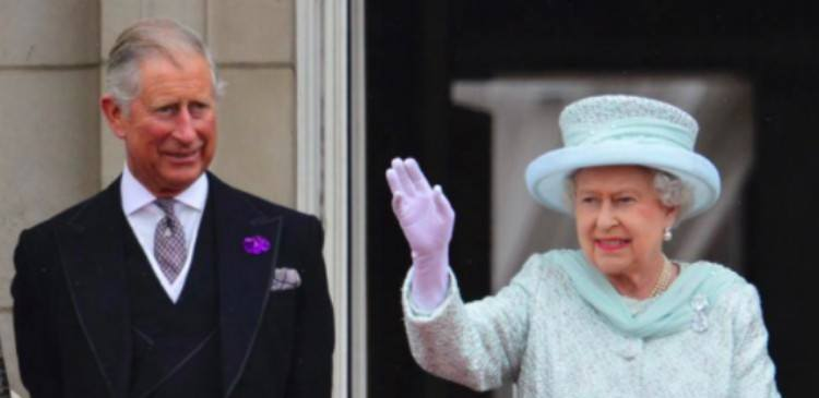 Queen Elizabeth waves next to Prince Charles