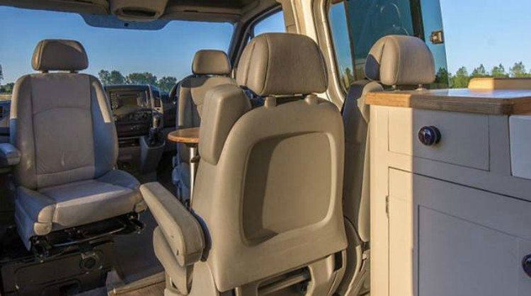 view of captain swivel chairs in camper van dining room