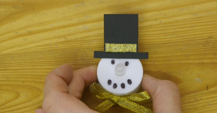 Tea light snowman with top hat.