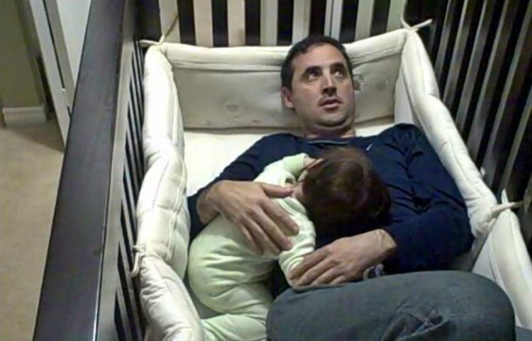 Father in Crib