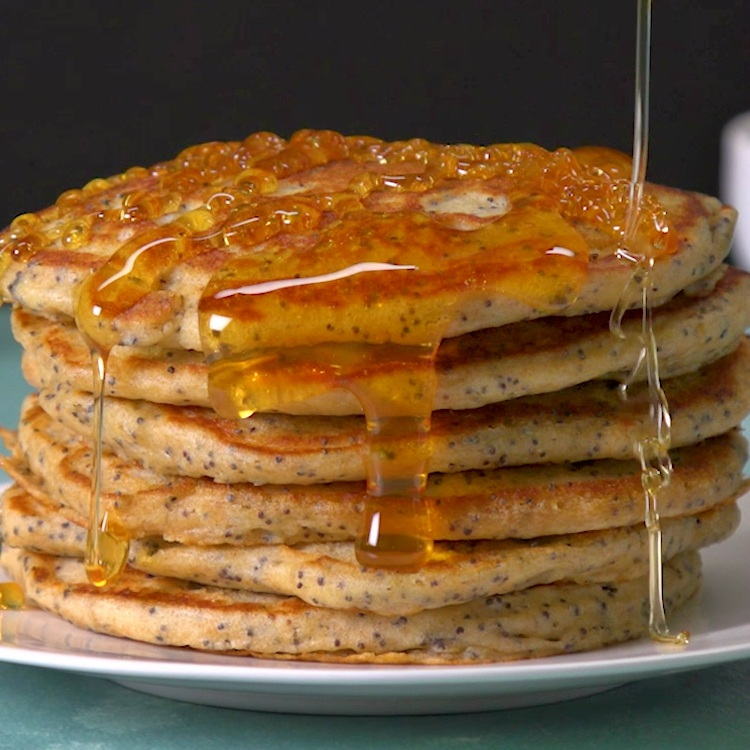 Fluffy buttermilk pancakes zing with bright lemony flavor from real lemon zest and juice, and plenty of poppy seeds add a subtle crunch.