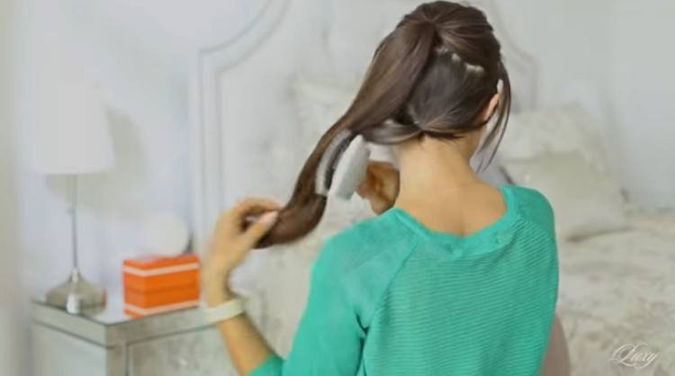 Brush bottom and top ponytails together to blend as one