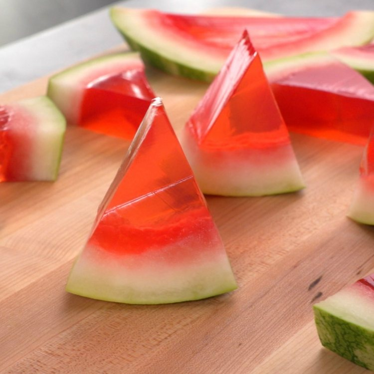 Watermelon jello shots cut into wedges for eating