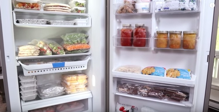 Upright freezer stocked with frozen make-ahead meals