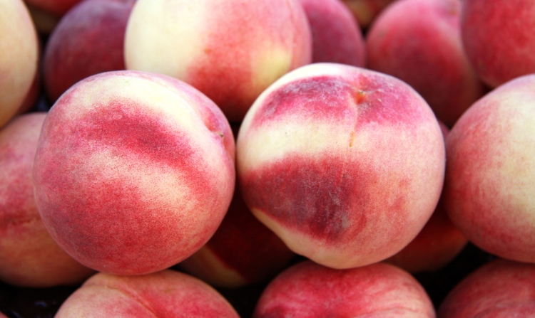 Image of Fresh peaches for sale at a market