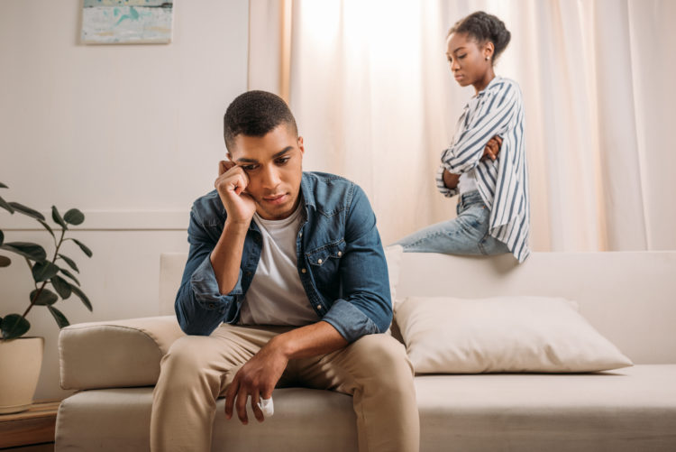 Image of unhappy couple on couch