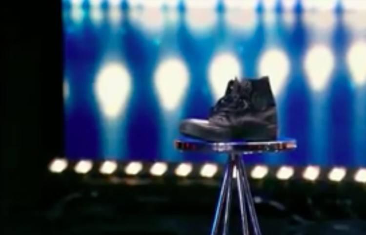 black sneaker sitting on a stool