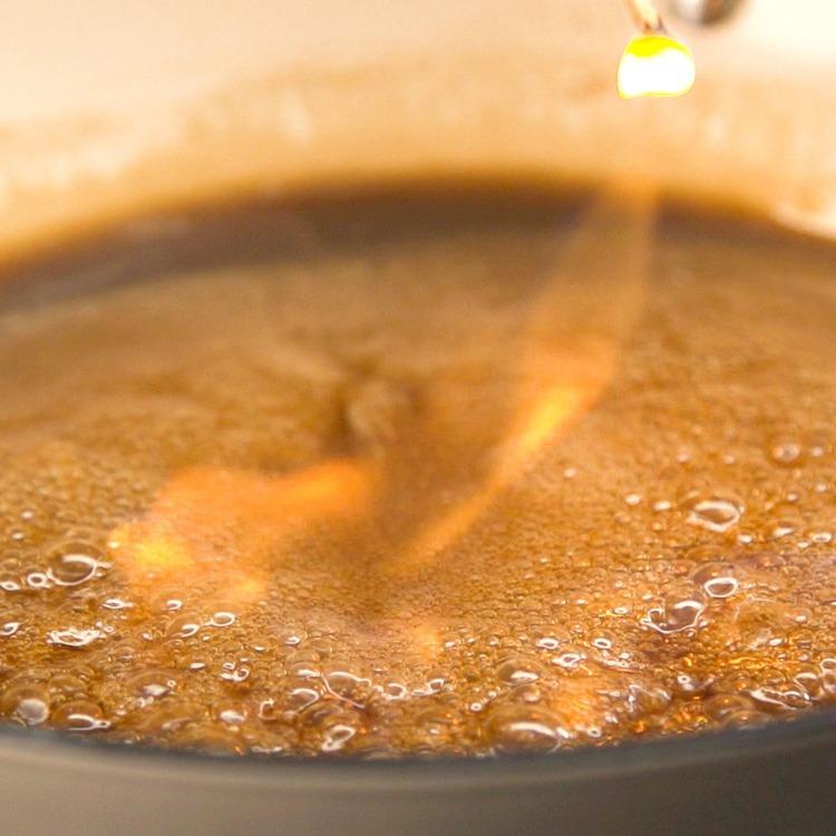 Shake pan until flames subside
