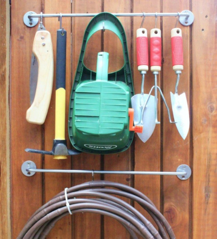 Gardening tools hung on towel bar.