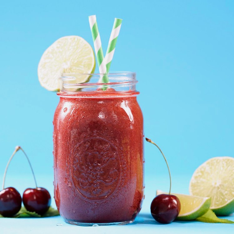 Tangy, refreshing, and healthy smoothie made with tart cherry juice, honey, banana, & lime -- plus a mason jar blender hack that will change your smoothie game.