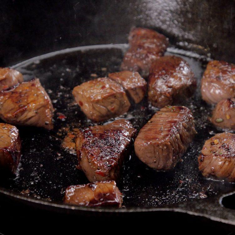 Honey Balsamic Steak Bites sizzling in the pan