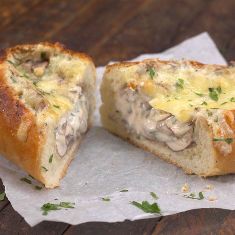 Slices of creamy garlic bread stuffed with mushrooms