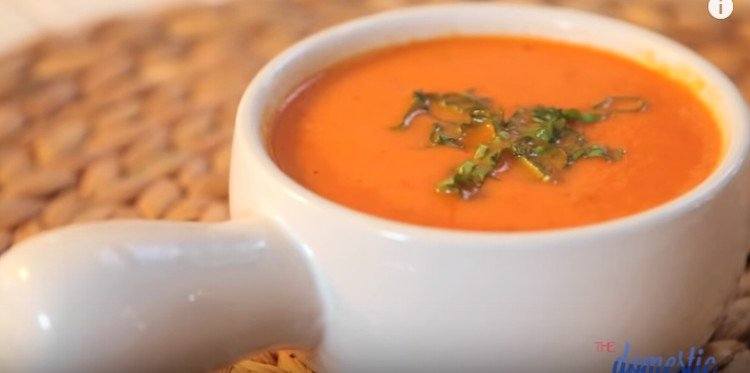 Cup of creamy homemade tomato soup.
